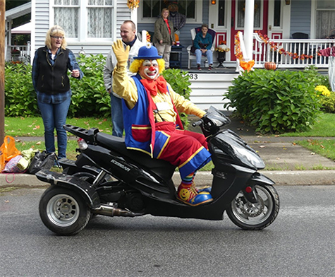 2018 Homecoming Parade with a clown on a motorcycle